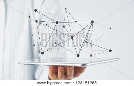Hand of businessman showing tablet pc as concept of global connectivity