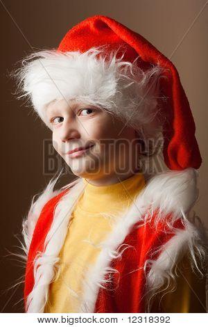 Little boy in Santa Claus suit