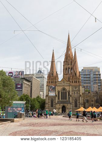 Melbourne - February 23 2016: Cathedral and the largest Anglican Cathedral of St. Paul in the Gothic style is located in the heart of Melbourne and Federation Square people on February 23 2016 Melbourne Australia