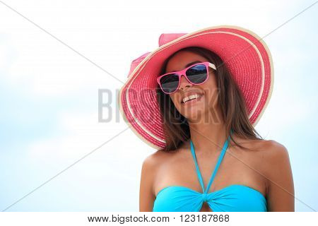 Portrait of a beautiful young woman in sunhat