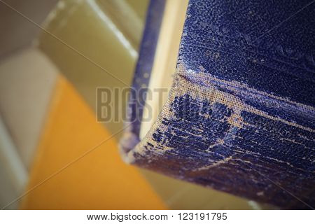 Ancient worn book with torn hardcover. Close-up photo