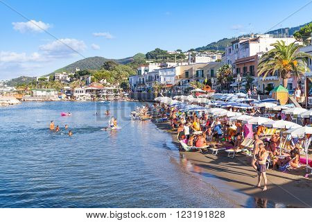 Crowd Of Resting Tourists On Public Beach, Ischia