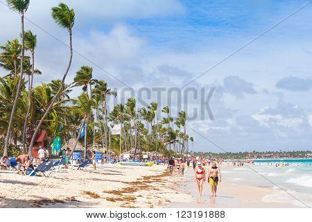 Atlantic Ocean Coast, Tourists Rest On A Sandy Beach