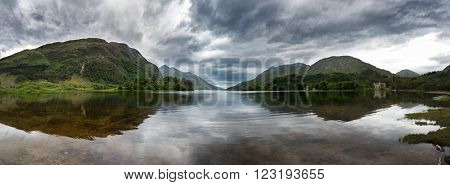 Highland panorama mirrored in the calm waters of Loch Shiel, Glenfinnan, Scotland, UK