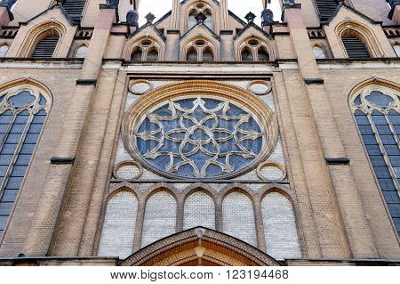 Holy Virgin Mary Cathedral's dominant rosette with stained glass on the facade above the entrance in Radom Poland