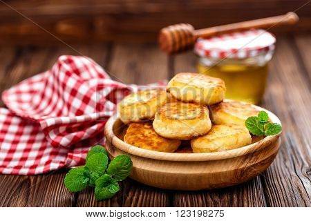 homemade curd fritters on plate on table ** Note: Shallow depth of field