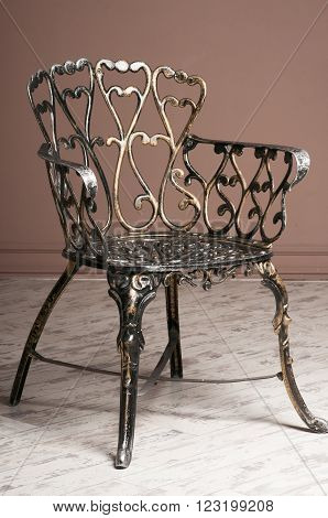 wrought-iron chair indoor on a white floor