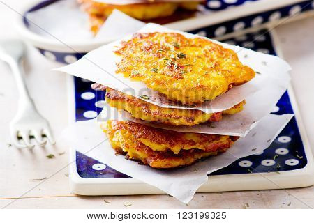 potato  and carrot fritters with a sausages