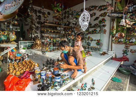 UBUD, INDONESIA - FEB 26, 2016: Unknown master in his art-workshop. Ubud is one of Bali's major arts and culture centres, it has developed a large tourism industry, has of about 30,000 population.