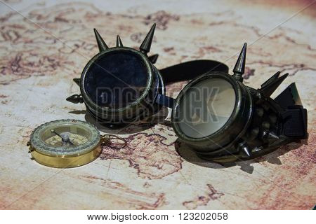 style glasses steampunk lying on old map