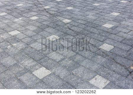 Perspective View of Monotone Gray dirty Brick Stone Street Road. Sidewalk Pavement Texture Background