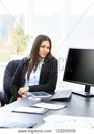 successful business woman working with documents in the office