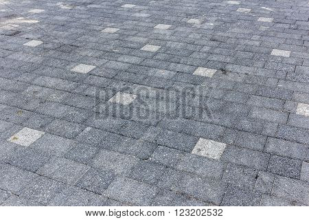 Perspective View Of Monotone Gray Dirty Brick Stone Street Road. Sidewalk, Pavement Texture Backgrou