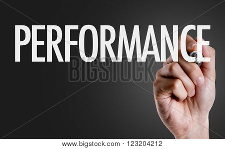 Hand writing the text: Performance