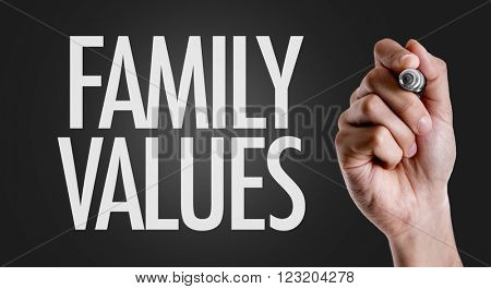 Hand writing the text: Family Values