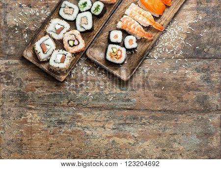 Traditional japanese food. Sushi rolls maki nigiri on wooden background