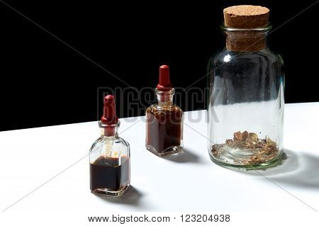 Three Glass Bottles With Herbal Extracts