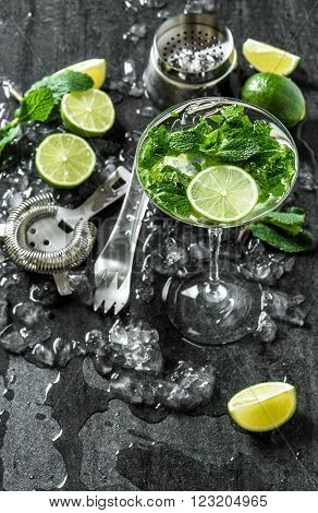 Glass of cocktail with lime mint ice. Tonik water mojito caipirinha. Top view
