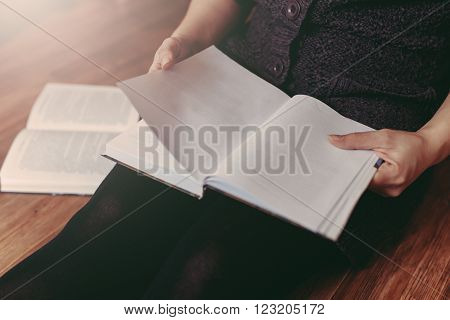 Woman Reading A Few Books On The Floor
