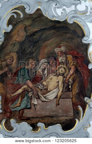 ROSENBERG, GERMANY - MAY 06: Jesus is laid in the tomb, Way of the Cross, fresco on the ceiling of the Church of Our Lady of Sorrows in Rosenberg, Germany on May 06, 2014.