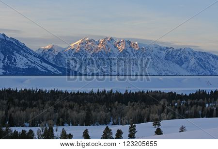 Mount Saint John at sunset in the Grand Tetons Mountain Range in Grand Tetons National Park in Wyoming USA