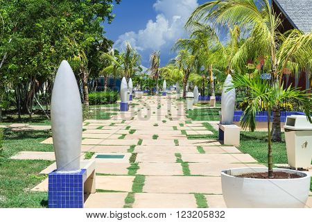 Cayo Coco island, Melia jardines del rey ,Cuba, Sep 2, 2015 beautiful amazing inviting view of alleyway through tropical garden toward beach and ocean
