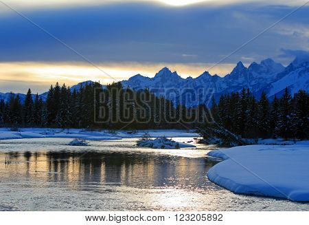 Snake River at sunset below the Grand Teton Mountain Range in Grand Tetons National Park in Wyoming USA