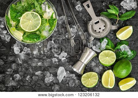 Cold drink glass with lime mint leaves ice. Mojito caipirinha lemonade tonic water
