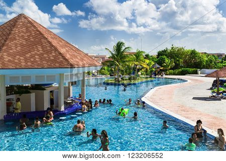 Cayo Coco,Memories Flamenco, Cuba, Sep.2, 2015, beautiful amazing gorgeous view of swimming pool with people swimming and relaxing near pool bar on sunny summer day