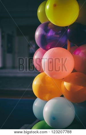 Photograph of some helium colorful balloons decoration