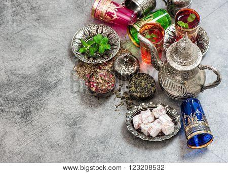 Tea with mint leaves and rose flower petals. Oriental hospitality concept. Holidays table setting. Ramadan kareem