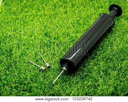 Metal inflation needle for inflatables and athletic balls included heavy duty pump on the grass