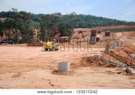 PERAK, MALAYSIA -FEBRUARY 14, 2016: Environmental aggression carried out to realize a development. Heavy vehicles used to moving soil to another place.