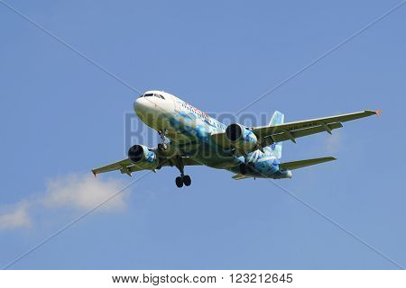 ST. PETERSBURG, RUSSIA - JUNE 29, 2015: Flying the Airbus A319-111 (VQ-BAS) of airline