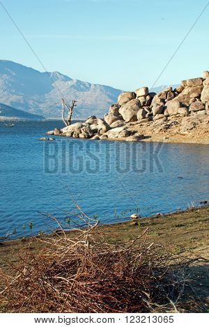Shoreline of drought stricken Lake Isabella in Central California USA in the southern Sierra Nevada mountain range