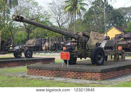 HUE, VIETNAM - JANUARY 08, 2016: 122-mm gun in a city park. The historic landmark of the city of Hue, Vietnam