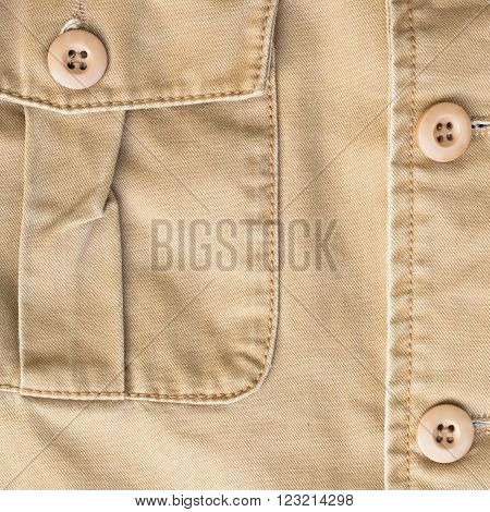 front pocket on brown shirt textile texture background
