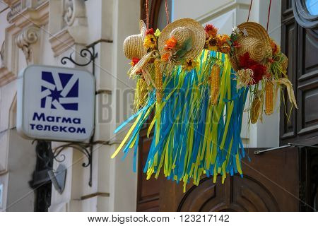Lviv Ukraine - July 4 2014: Decorative wreath with straw hats and blue and yellow strips above the entrance door