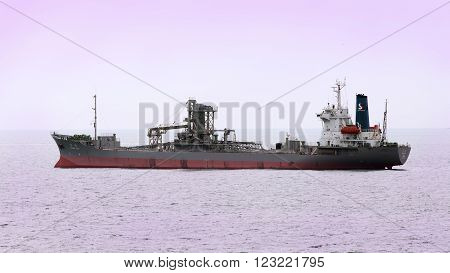 Busan, South Korea - February 19th, 2016: Busan, road of the port of Busan, anchorage of sea vessels, the vessel for cement transportation CHUNG YANG.