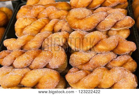 Sweet donuts fried in vegetable oil and strewed with icing sugar
