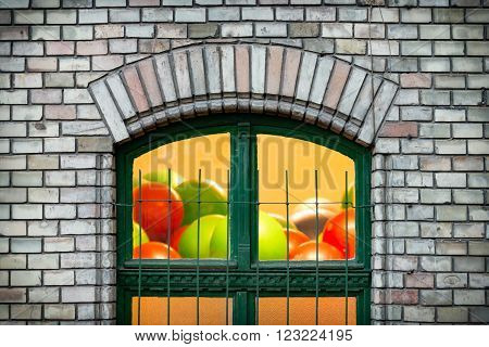 Details of old town architecture. Green window in old brick wall. Budapest Hungary Europe travel.