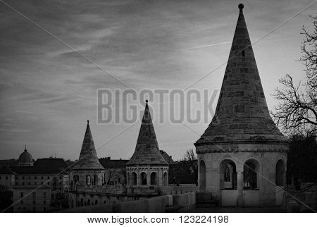 Black and white view on towers of fisherman bastion. Buda hill Budapest Hungary Europe travel. Some grain added.