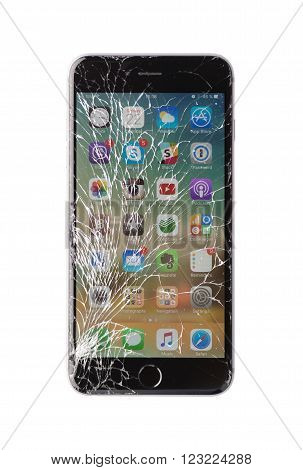 Moscow Russia - November 22 2015: Photo of iPhone 6 plus with broken display. Modern smartphone with damaged glass screen isolated on white background. Device needs repair.