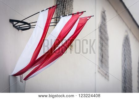 Austrian flag on wall of building in old town Vienna. Europe travel.