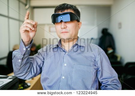 A man in 3d computer glasses touching the air
