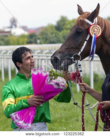 PYATIGORSK,RUSSIA - AUGUST 04,2013:Unknown jockey, winner of the prize Big Summer in Pyatigorsk,Caucasus, Russia on August 04,2013.