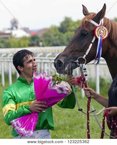 PYATIGORSK,RUSSIA - AUGUST 04,2013:Unknown jockey, winner of the prize Big Summer in Pyatigorsk,Caucasus, Russia on August 04,2013.