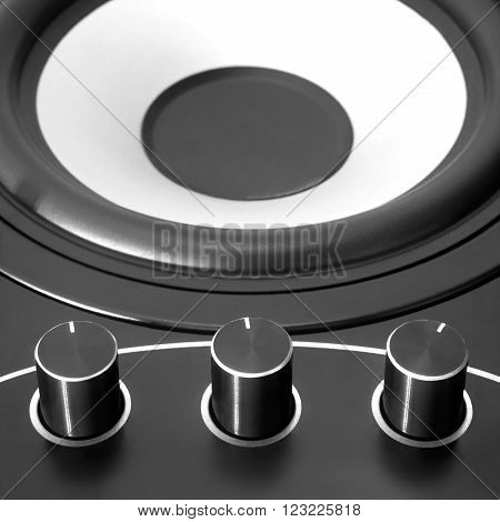 Black woofer with three dampers and white speaker ** Note: Shallow depth of field