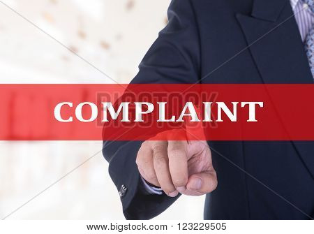 Businessman hand touch label complaint, on the screen.