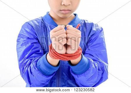 Boy Hands Is Tight By Red Nylon Rope